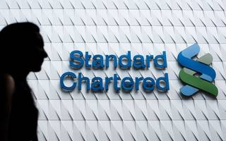 standard chartered's thai unit offloads retail banking arm