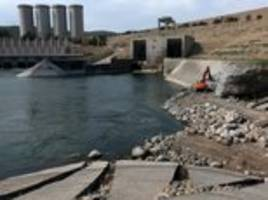 'it would be worse than a nuclear bomb:' allied troops and isis to battle for collapsing mosul dam that would spew out 4.4million olympic size swimming pools of water if it breaches
