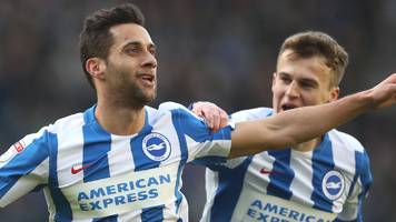 brighton win to go top of championship