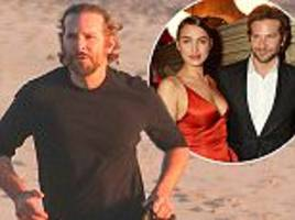 no dad bod here! 'father-to-be' bradley cooper works up a sweat as he goes jogging during romantic break with girlfriend irina shayk