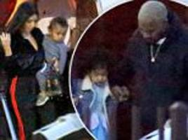 kim kardashian and kanye west touch down with north and saint in la