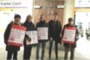 action group protest at exeter train station over increase in...
