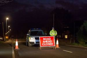 cambridgeshire double death crash: driver on the run 'breaks into nearby house and buries £100k in garden'