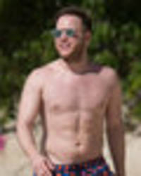 olly murs flaunts toned torso as he jets off to barbados