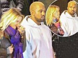 kanye west fails to raise a smile as he leaves la restaurant with female companions