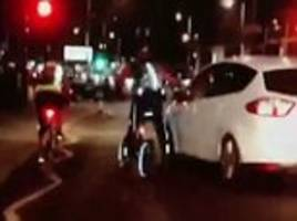 'no winners here': bbc presenter jeremy vine takes aim at another driver while out cycling as he films a car trying to squeeze past a woman on her bike but had she gone through two red lights first?