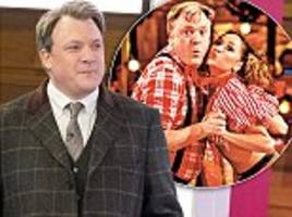 introducing ed balls as the milk tray man (and, yes, the ladies love him): former mp ditches his daytime suit and tie for 'country gent' look featuring a polo neck and chelsea boots