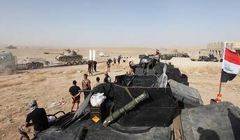 mosul battle: iraqi forces take key district from is