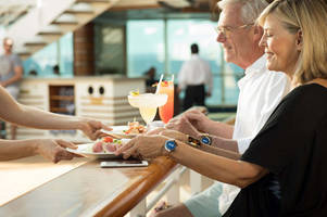 carnival's wearable for guests aims to enhance your cruise experience