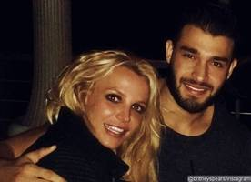 britney spears and new beau sam asghari spotted getting flirty at pal's birthday party