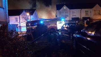 west belfast: houses evacuated after petrol station fire