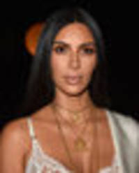 Kim Kardashian robbed AGAIN: Suspect runs off with £1,300 worth of clothes and jewellery