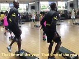 usain bolt trains in borussia dortmund kit and claims it's 'that time of year'