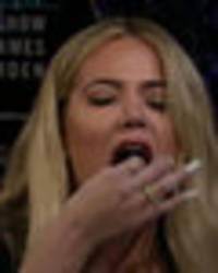 Khloé Kardashian eats fish eyes to avoid talking about OJ Simpson in hilarious game