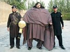 Pakistani man who weighs 68-STONE eats 36 eggs for breakfast and 7lb of meat a day