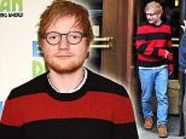 slimmed down ed sheeran is swamped by his red striped jumper as he steps out after shedding 3.5 stone