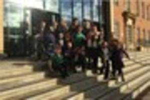 school strikes prompt parents to gather outside derby council...