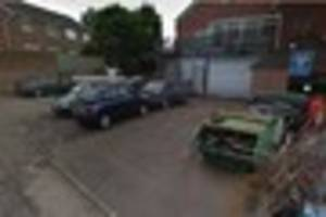 Firefighters deal with eight-car blaze in garage forecourt