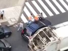 facing the sack? spanish binmen to be disciplined after they jumped out of their dustcart to fight two people during a shocking road rage row