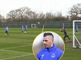 everton new boy morgan schneiderlin announces himself on his first day of training as he rifles home a screamer in shooting practice
