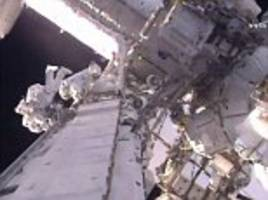 watch live as spacewalking astronauts step outside the iss to fit new fridge-sized batteries