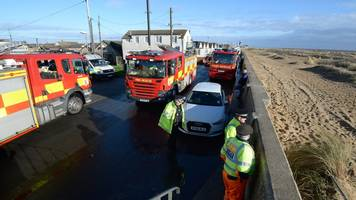flood warnings: evacuations continue in essex and suffolk