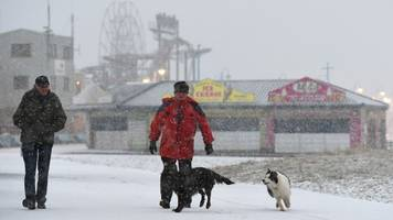 flood threat as snow and wintry weather grip uk