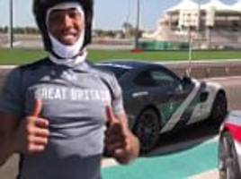 anthony joshua shows off speed to go with famous power as ibf champion enjoys day at abu dhabi race track