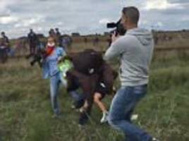hungarian camerawoman filmed tripping over migrants crossing the border is sentenced