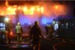 Police hunt suspected arsonists who set former school on fire