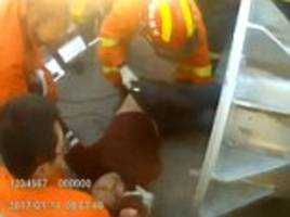 Drunk man rescued after getting himself trapped INSIDE utility pole