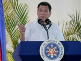 duterte tells civilians 'don't get yourselves kidnapped' as he orders troops to bomb hostage-takers and threatens to declare martial law as part of philippines' drug war