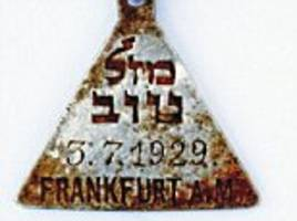 pendant almost identical to one owned by anne frank is found at concentration camp