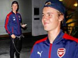 justin bieber reaffirms love for arsenal fc by rocking a team jacket in la