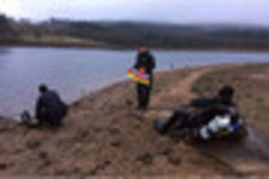 watch police divers and search teams return to burrator reservoir...
