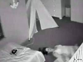 mother slides out of baby's room on her back