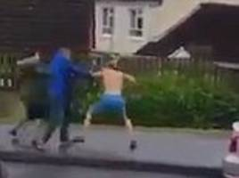 thugs attack each other with irish hurling sticks