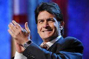 Charlie Sheen Apologizes to Rihanna After Calling Her 'That B—-'