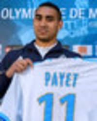 Snapped: Dimitri Payet poses with Marseille shirt… and he doesn't look too happy