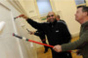 volunteers help out in diy sos-style makeover at nottingham...