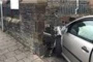 a car has crashed into the side of a police station knocking down...