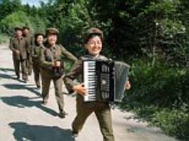 Photographer releases banned images North Korean officials