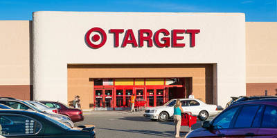 target tumbles after cutting guidance, reports poor comps; drags wal-mart lower