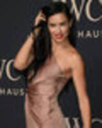 adriana lima risks exposing privates in crotch-skimming split gown