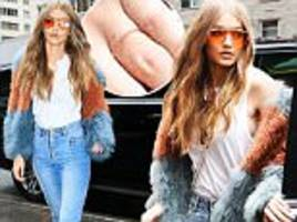 gigi hadid fuels engagement rumor with band on ring finger