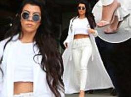 Kourtney Kardashian flashes midriff in crop top and jeans