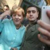 Dear Facebook, This Man Is Not a Terrorist: Selfie with Merkel Haunts Refugee