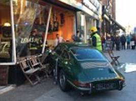50-year-old classic porsche ploughs into cafe