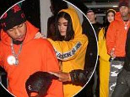 Kylie Jenner and Tyga wear bright tracksuits for party