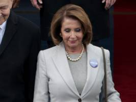 democrats are wearing 'protect our care' pins at the inauguration to protest the repeal of obamacare